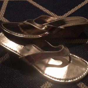Gold wedge flip flops